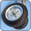 Two 10 inch solid rubber wheels combined with steel centres for added strength
